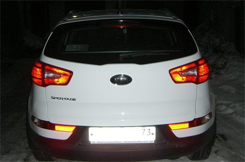Задние засвеченные фонари KIA Sportage 3 SL (фото со вспышкой)