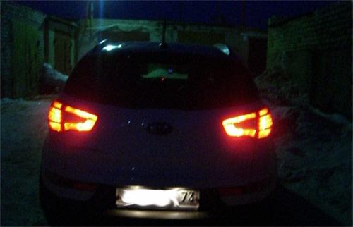 Задние засвеченные фонари KIA Sportage 3 SL (фото без вспышки)